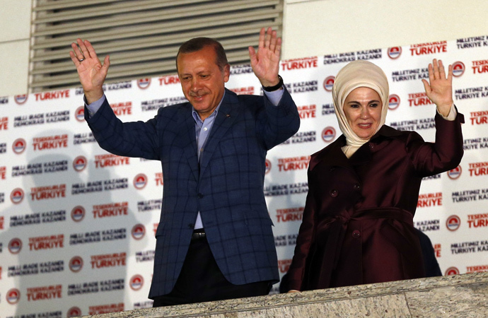 Turkey's Prime Minister Tayyip Erdogan and wife Ermine wave hands to supporters as they celebrate his election victory in front of the party headquarters in Ankara August 10, 2014. (Reuters / Umit Bektas)