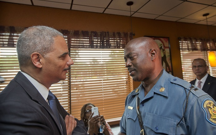 Attorney General Eric Holder talks with Capt. Ron Johnson of the Missouri State Highway Patrol at Drake's Place Restaurant in Florrissant, Missouri August 20, 2014. (Reuters/Pablo Martinez Monsivais/Pool)