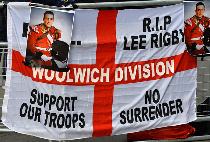 A banner and photographs of murdered soldier Lee Rigby are displayed during a protest outside the Old Bailey courthouse in London February 26, 2014 (Reuters / Toby Melville)