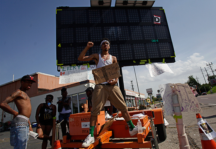 Demonstrators protest the shooting of Michael Brown in Ferguson, Missouri August 23, 2014 (Reuters / Joshua Lott)