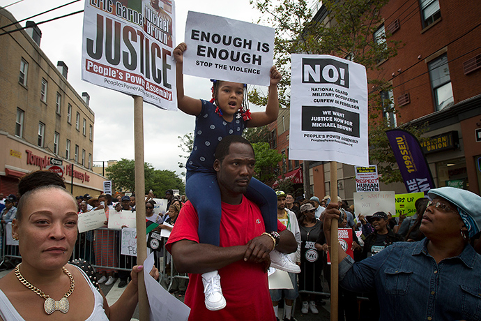 """People take part in the """"We Will Not Go Back"""" march and rally for Eric Garner in the Staten Island borough of New York August 23, 2014 (Reuters / Carlo Allegri)"""