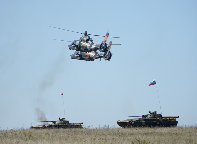 ARCHIVE PHOTO: Chinese Z9B helicopters and Russian BMP-2 vehicles during practical training held as part of the Peace Mission 2013, a Russia-China joint anti-terrorism drill, at the Chebarkul firing range. (RIA Novosti / Pavel Lisitsyn)