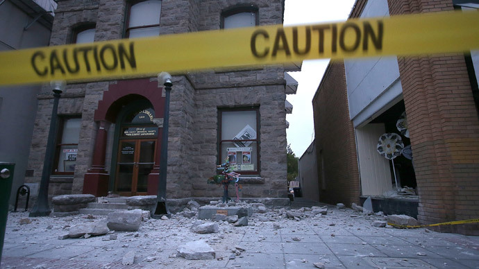 Debris sits on the ground in front of a damaged building following a reported 6.0 earthquake on August 24, 2014 in Napa, California.(AFP Photo / Justin Sullivan)