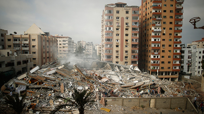 A general view of the rubble of a residential tower, which witnesses said was destroyed in an Israeli air strike, is seen in Gaza City August 24, 2014 (Reuters / Mohammed Salem)