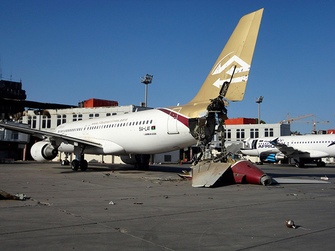 A damaged aircraft is pictured after shelling at Tripoli International Airport August 24, 2014 (Reuters / Aimen Elsahli)
