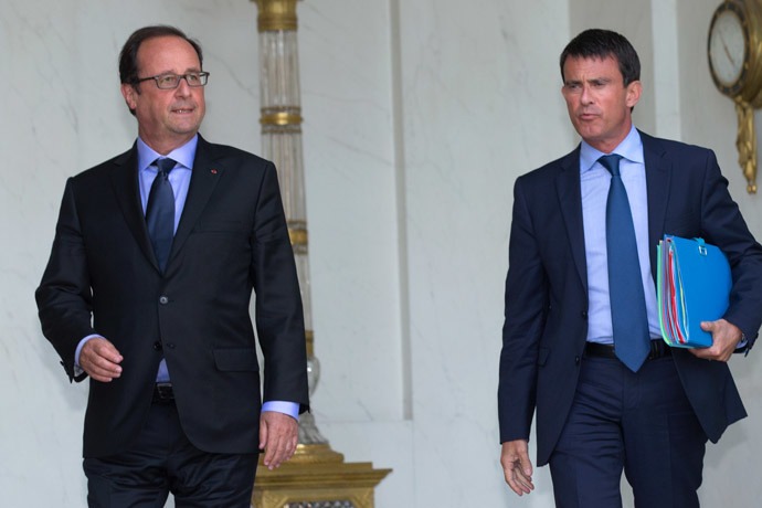 French President Francois Hollande and Prime Minister Manuel Valls.(Reuters / Philippe Wojazer)