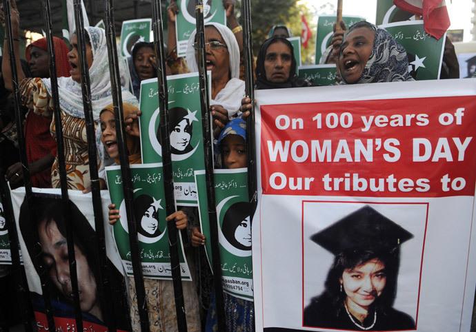Pakistani protestors from the hard line Sunni group, Pasban, hold portraits of Pakistani scientist Aafia Siddiqui during a demonstration marking International Women's Day.(AFP Photo / Rizwan Tabassum)