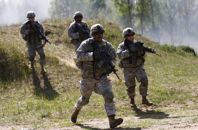 Paratroopers from the U.S. Army's 173rd Infantry Brigade Combat Team participate in training exercises with the Polish 6 Airborne Brigade soldiers at the Land Forces Training Centre in Oleszno near Drawsko Pomorskie, north west Poland, May 1, 2014. (Reuters/Kacper Pempel)
