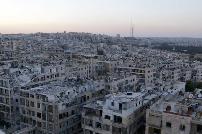 A general view shows damaged buildings in Aleppo's al-Ansari neighbourhood June 14, 2014. Picture taken June 14. (Reuters/Hosam Katan)