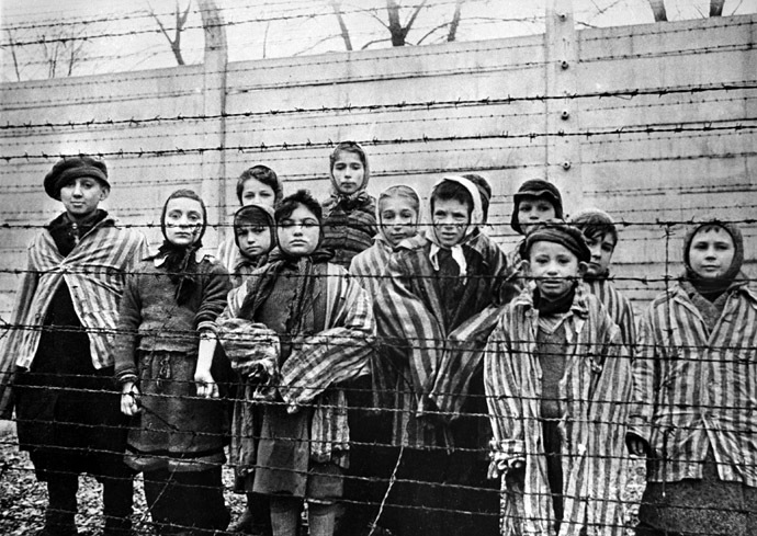 Children behind the wire in the Auschwitz concentration camp. (RIA Novosti/Fishman)