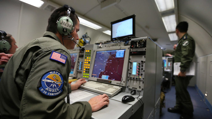 A controller monitors at screens aboard a NATO AWACS.(Reuters / Francois Lenoir)
