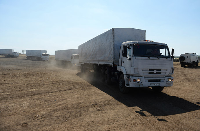 A column of KamAZ trucks that delivered humanitarian aid to Lugnask leaves the Rostov region towards the Moscow region. (RIA Novosti / Maksim Blinov)