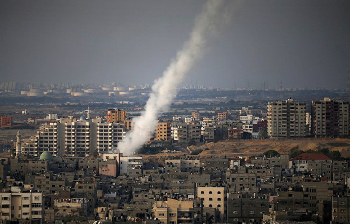 A picture taken from Gaza city shows the smoke that results from the launch of a long-range rocket from the north of the city towards Israel on July 12, 2014 following an advance warning of the attack by Ezzedine al-Qassam Brigades, the military wing of Hamas. (AFP Photo / Thomas Coex)