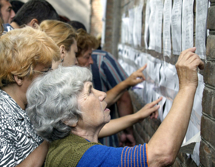 Relatives of terrorist act victims check the lists of injured at the hospital in the town of Beslan, North Ossetia, 04 September 2004, after Russian security forces gained control of the school where up to 1000 children and adults had been held hostage by armed rebels. (AFP Photo)