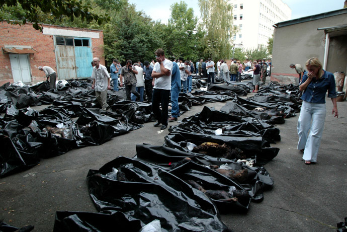 People search for relatives among the bodies of dead hostages at a morgue in the town of Vladikavkaz, September 4, 2004. (Reuters/Sergei Karpukhin)