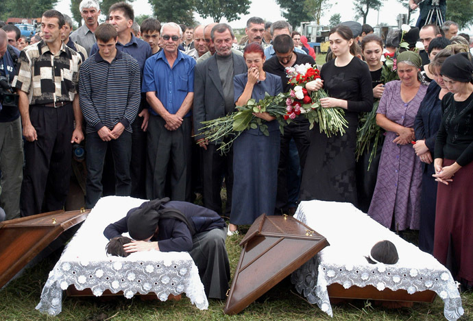 Fatima Tetova, mother of killed hostages Irina,13 and Alina,12, cry during their funeral in the town of Beslan in the province of North Ossetia near Chechnya , September 5, 2004. (Reuters)