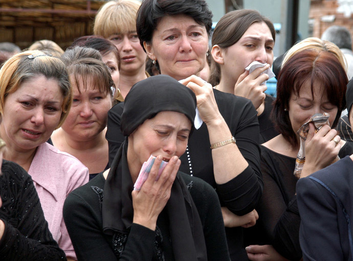 Relatives and neighbours of killed sisters hostages Irina,13 and Alina,12 Tetova cry during their funeral in the town of Beslan in the province of North Ossetia near Chechnya, September 5, 2004. (Reuters)