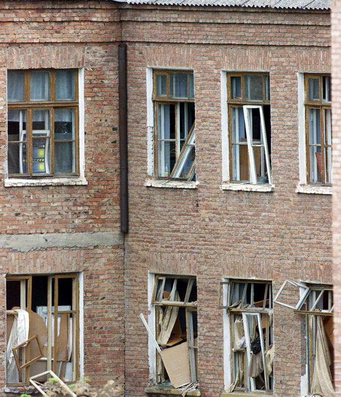 Broken windows are seen at the rear of a school building seized by heavily armed masked men and women in the town of Beslan in the province of North Ossetia. Broken windows are seen at the rear of a school building seized by heavily armed masked men and women in the town of Beslan in the province of North Ossetia near Chechnya, September 2, 2004. (Reuters)