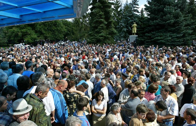 Hundreds of Ossetian inhabitants, relatives of hostages wait outside the school, where a group of gunmen, wearing belts laden with explosives, are holding hostage some 350 people in the northern Ossetian town of Beslan, some 30 kms outside Vladikavkaz, 02 September 2004. (AFP Photo/Maxim Marmur)