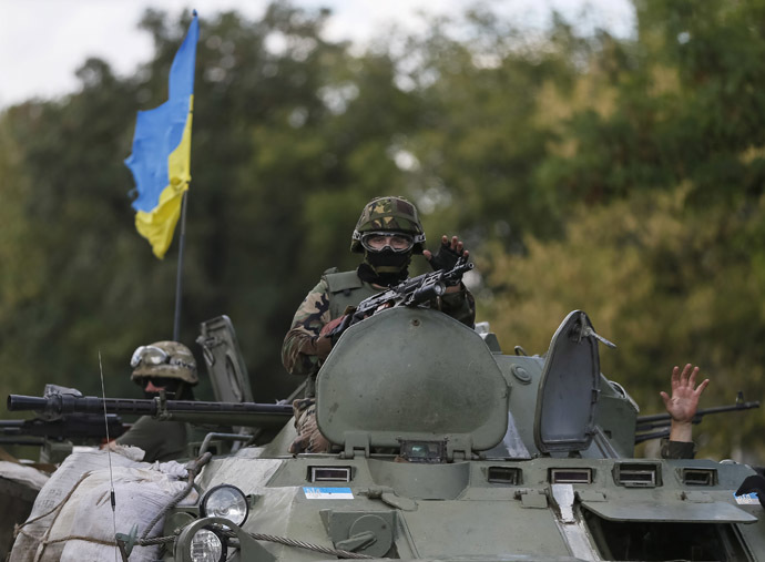 Ukrainian servicemen ride in an armoured vehicle near Debaltseve, Donetsk region, August 29, 2014. (Reuters/Gleb Garanich)