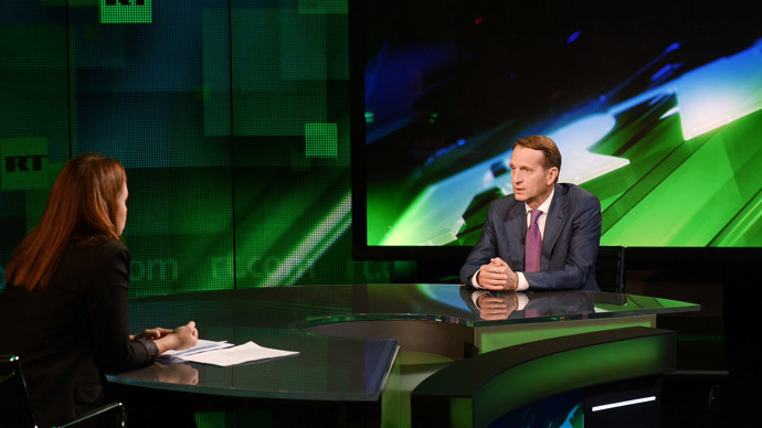 State Duma Speaker Sergey Naryshkin and RT's correspondent Madina Kochenova at RT on August 30, 2014 (Image by RIA Novosti)