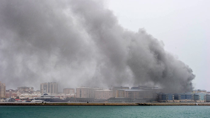 Smoke billows from Gibraltar's power plant following an explosion, in Gibraltar on April 20, 2014.(AFP Photo / Marcos Moreno)
