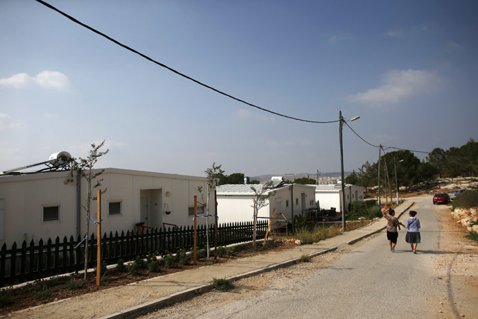"Israeli women walk in a Jewish settlement known as ""Gevaot"", in the Etzion settlement bloc, near Bethlehem August 31, 2014. (Reuters/Ronen Zvulun)"