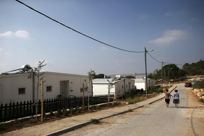 "Israeli women walk in a Jewish settlement known as ""Gevaot"", in the Etzion settlement bloc, near Bethlehem August 31, 2014. (Reuters/Ronen Zvulun)"
