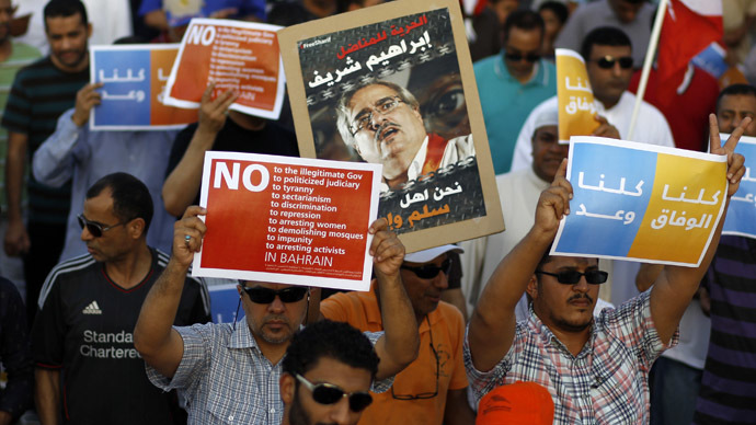 Protesters holding anti-government banners participate in a rally organised by Bahrain's main opposition party Al Wefaq in Budaiya August 8, 2014. (Reuters/Hamad I Mohammed)