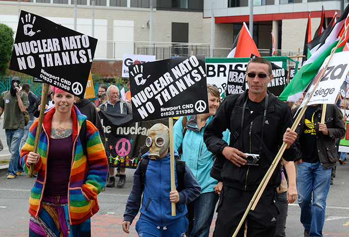 Demonstrators take part in an anti-war protest march in Newport, Wales, August 30, 2014. (Reuters / Rebecca Naden)