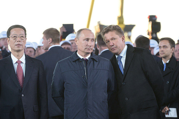 September 1, 2014. Russian President Vladimir Putin, right, at the ceremony marking the joining of the first link in the Power of Siberia main gas pipeline, held at Namsky Highway near Us Khatyn village. Gazprom Board Chairman Alexei Miller, right. Vice Premier of the People's Republic of China Zhang Gaoli, left (RIA Novosti / Alexey Nikolsky)