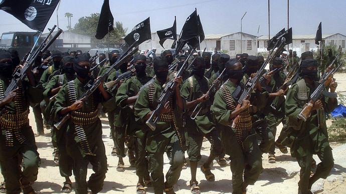Islamist fighters loyal to Somalia's Al-Qaida inspired al-Shebab group perform military drills at a village in Lower Shabelle region, some 25 kilometres outside Mogadishu.(AFP Photo / Abdurashid Abdulle )