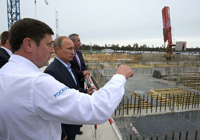 September 2, 2014. President Vladimir Putin, second left, Head of the Russian Space Agency Oleg Ostapenko, left, and Deputy Prime Minister Dmitry Rogozin during a visit to the Vostochny Cosmodrome. (RIA Novosti / Alexei Druzhinin)