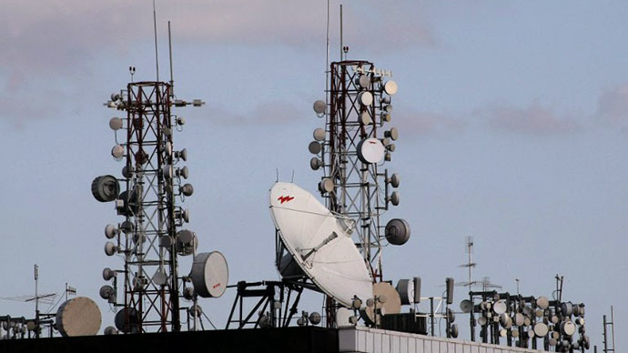Satellite dishes and cell phone towers atop a roof of a building (AFP Photo / Thomas Coex)