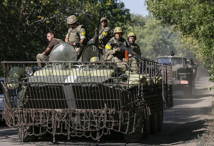 Ukrainian servicemen ride in an armoured vehicle near Kramatorsk September 2, 2014. (Reuters/Gleb Garanich)