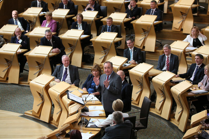 Scotland's First Minister, Alex Salmond (STANDING), addresses Members of the Scottish Parliament (MSP), during First Minister's Question Time, the last before Scotland votes in a referendum on independence, in Edinburgh August 21, 2014. (Reuters/Paul Hackett)