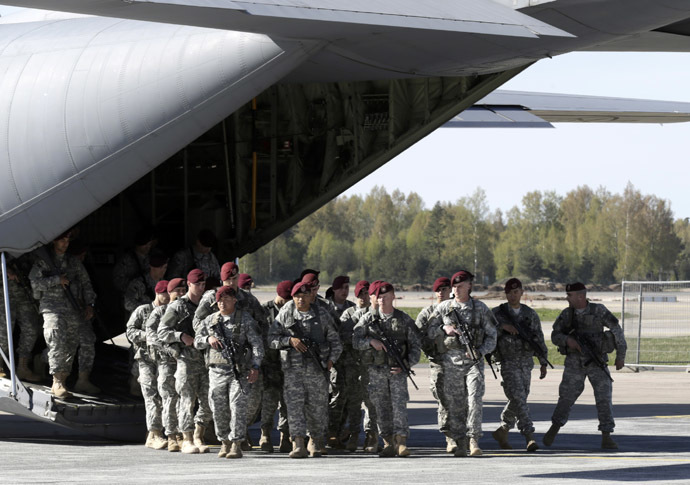 irst company-sized contingent of about 150 U.S. paratroopers from the U.S. Army's 173rd Infantry Brigade Combat Team based in Italy arrive in the airport in Riga April 24, 2014. (Reuters/Ints Kalnins)