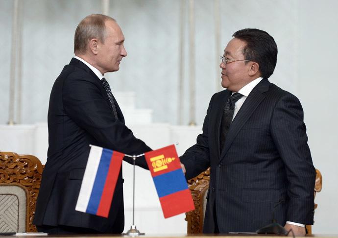 Russian President Vladimir Putin, left, and his Mongolian counterpart Tsakhiagiin Elbegdorj sign joint agreements following Russian-Mongolian talks at State Palace in Ulan-Bator. (RIA Novosti/Aleksey Nikolskyi)