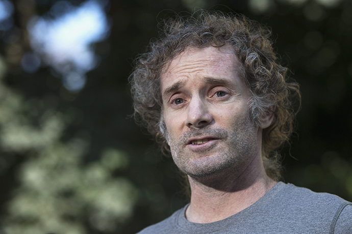 Peter Theo Curtis, who was released on Sunday from two years in the captivity of insurgents in Syria, talks to reporters near his mother's home in Cambridge, Massachusetts August 27, 2014. (Reuters / Brian Snyder)