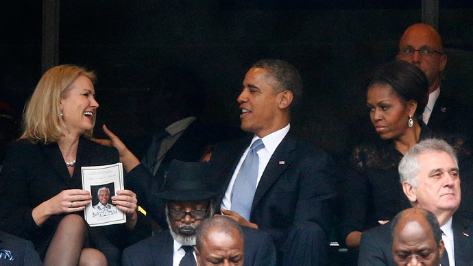 U.S. President Barack Obama (C) shares a moment with Denmark's Prime Minister Helle Thorning-Schmidt (L) as his wife, first lady Michelle Obama looks on (R) during the memorial service for late South African President Nelson Mandela at the First National Bank stadium, also known as Soccer City, in Johannesburg December 10, 2013.(Reuters / Kai Pfaffenbach)
