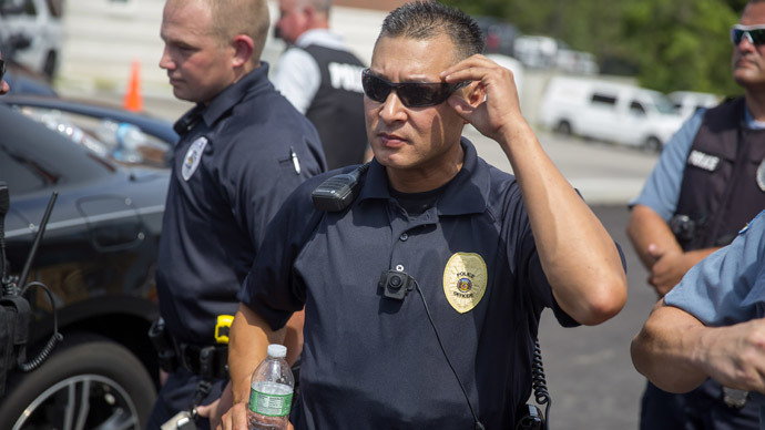 A police officer wears a body camera at a rally for Michael Brown August 30, 2014 in Ferguson, Missouri.(AFP Photo / Aaron P. Bernstein)