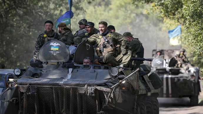 Ukrainian paratroopers ride in armoured vehicles near Kramatorsk September 4, 2014. (Reuters/Gleb Garanich)