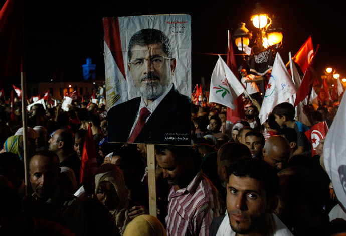 Supporters of the Islamist Ennahda movement hold a portrait of ousted Mohamed Morsi during a demonstration at Kasbah Square in Tunis August 3, 2013.(Reuters / Zoubeir Souissi)