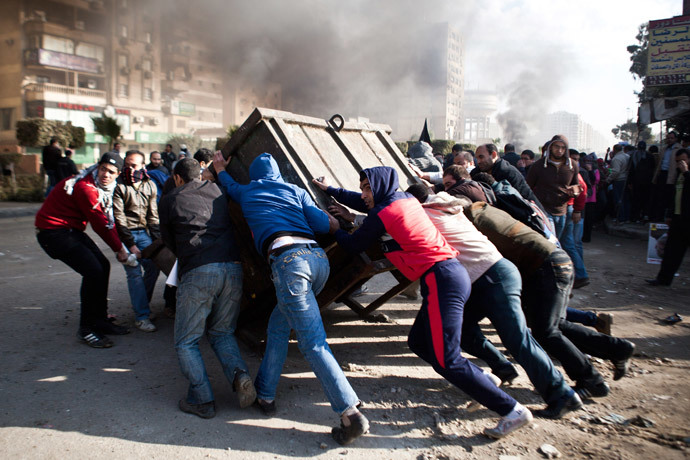 Supporters of ousted Mohamed Morsi block a street during clashes with Egyptian security forces in Nasr City, Cairo on January 8, 2014.(AFP Photo / Virginie Nguyen Hoang )