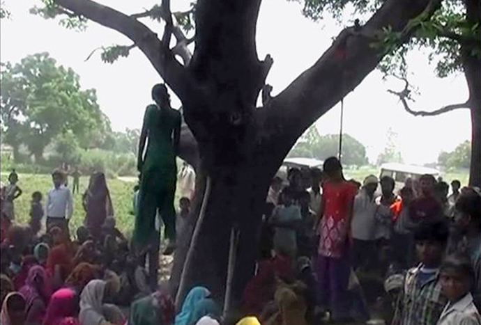 Two girls are seen hanging from a tree in a village in the northern Indian state of Uttar Pradesh on May 28, 2014, in this still image taken from video. (Reuters)