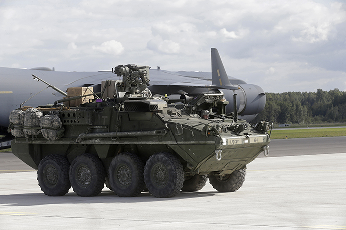 "U.S.173 airborne brigade soldiers arrive in armoured personal carrier ""Stryker"" for the ""Steadfast Javelin II"" military exercise in the Lielvarde air base, September 6, 2014. (Reuters / Ints Kalnins)"