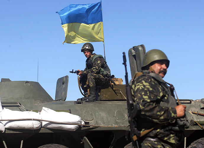 A Ukrainian serviceman sit ontop of an armoured personnel carrier during a patrol on the border of the Donetsk and Luhansk regions near town of Debaltseve, on September 5, 2014. (AFP Photo / Anatoliy Stepanov)