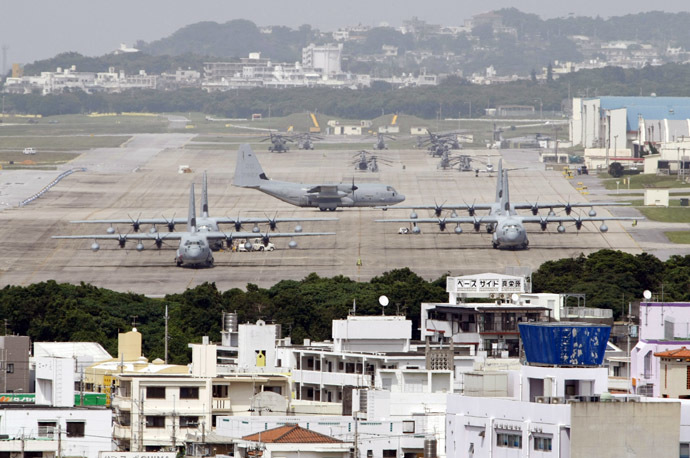 Hercules aircraft are parked on the tarmac at Marine Corps Air Station Futenma in Ginowan on Okinawa May 3, 2010. (Reuters/Issei Kato)