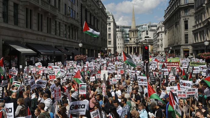Demonstrators join a rally to support the people of Gaza, in central London, August 9, 2014. (Reuters / Luke MacGregor)