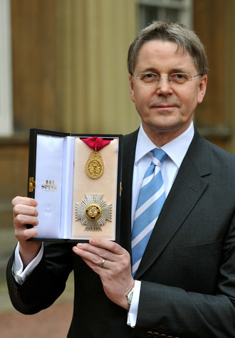 Jeremy Heywood, permanent secretary at No 10 and Cabinet Secretary, poses with his medal after was made a Knight Commander of the Order of the Bath by the Prince of Wales at Buckingham Palace during an investiture ceremony on May 4, 2012. (AFP Photo/John Stillwell